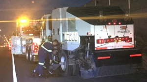 Police say a 48-year-old man is facing impaired driving charges after a streetsweeper was pulled over on the QEW last week. (OPP Sgt. Kerry Schmidt/ Twitter)