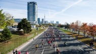 Competitors race along Lakeshore Boulevard during the Toronto Marathon on Sunday, October 22, 2017. THE CANADIAN PRESS/Christopher Katsarov