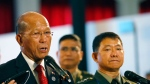Philippine Defense Secretary Delfin Lorenzana, left, together with Armed Forces Chief Gen. Eduardo Ano, right, reads a statement announcing the Philippine troops have captured a building where pro-Islamic State group militants made their final stand in southern Marawi city and found bodies of suspected gunmen inside Monday, Oct. 23, 2017 at the ongoing ASEAN Defense Ministers' Meeting in Clark, Pampanga province north of Manila, Philippines. The seizure of the building and the defeat of the militants would allowed the military to declare on Monday the end of the Marawi siege, which hundreds of black flag-waving gunmen launched exactly five months ago. (AP Photo/Bullit Marquez)