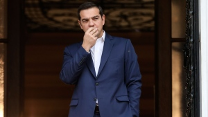 Greece's Prime Minister Alexis Tsipras waits outside his office in Athens, Monday, Oct. 23, 2017. Bailout negotiators are returning to Greece to try and reach a deal by the end of the year on the terms for the next loan payout, as the debt-plagued country prepares to end eight years of rescue funding programs next summer. (AP Photo/Yorgos Karahalis)