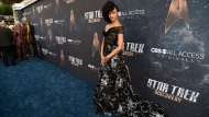"""Sonequa Martin-Green, a cast member in """"Star Trek: Discovery,"""" poses at the premiere of the new television series on Tuesday, Sept. 19, 2017, in Los Angeles. (Photo by Chris Pizzello/Invision/AP)"""