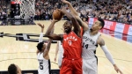 Toronto Raptors forward Serge Ibaka (9) drives to the basket against San Antonio Spurs guard Danny Green (14) as he tires to score during the first half of an NBA basketball game, Monday, Oct. 23, 2017, in San Antonio. (AP Photo/Eric Gay)