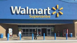 Walmart expanded technology that allows shoppers to choose to carry a scanner that tallies up their purchases to 20 stores in B.C., Alberta and Ontario on Monday. (File image)