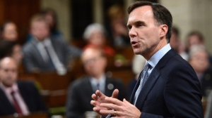 Minister of Finance Bill Morneau stands during question period in the House of Commons on Parliament Hill in Ottawa on Monday, Oct. 23, 2017. THE CANADIAN PRESS/Sean Kilpatrick