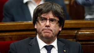 Then Catalan President Carles Puigdemont attends a parliamentary session at the Catalan parliament in Barcelona, Spain, Thursday, Oct. 26, 2017. (AP Photo/Manu Fernandez)