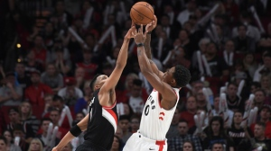 Portland Trail Blazers guard Evan Turner blocks the shot of Toronto Raptors guard DeMar DeRozan during the fourth quarter of an NBA basketball game in Portland, Ore., Monday, Oct. 30, 2017. The Raptors won 99-85. (AP Photo/Steve Dykes)