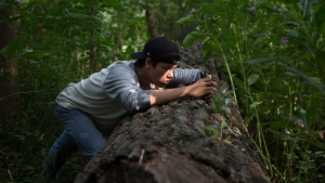 "Jeremiah McLaughlin Assinewai, an Indigenous youth and a member of the Native Canadian Centre of Toronto takes a picture on a smartphone in Toronto's High Park as he participates in Jayu's ""iAm"" program on Tuesday, August 28, 2017. THE CANADIAN PRESS/Chris Young"