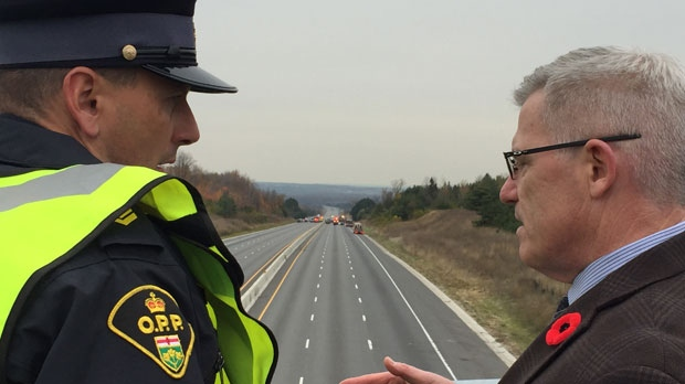 Sgt. Kerry Schmidt with OPP is seen talking to OPP Commissioner Vince Hawkes at the scene of the deadly crash on Highway 400 near Highway 89 on Wednesday. (CP24/Nick Dixon)