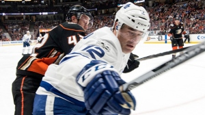 Toronto Maple Leafs center Patrick Marleau, front, and Anaheim Ducks defenseman Josh Manson battle for the puck during the third period of an NHL hockey game Wednesday, Nov. 1, 2017, in Anaheim, Calif. (AP Photo/Kyusung Gong)
