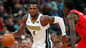 Denver Nuggets forward Paul Millsap, left, picks up a loose ball as Toronto Raptors forward Pascal Siakam, of Cameroon, pursues in the second half of an NBA basketball game Wednesday, Nov. 1, 2017, in Denver. The Nuggets won 129-111. (AP Photo/David Zalubowski)
