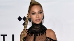 In this Oct. 15, 2016 file photo, singer Beyonce Knowles attends the Tidal X: 1015 benefit concert in New York. Beyonce is nominated for Grammy Awards for best album, best song and record of the year. (Photo by Evan Agostini/Invision/AP, File)