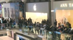 A large crowd lines up outside the Eaton Centre Apple store on Friday ahead of the new iPhone X going on sale.