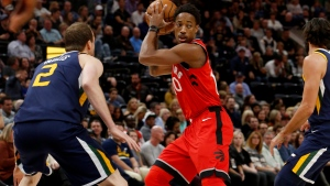 Toronto Raptors' DeMar DeRozan, middle, looks to pass as Utah Jazz's Joe Ingles (2) defends during the first half of an NBA basketball game Friday, Nov. 3, 2017, in Salt Lake City. (AP Photo/Kim Raff)