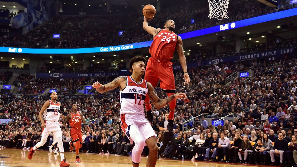 Toronto Raptors forward Norman Powell (24) dunks past Washington Wizards forward Kelly Oubre Jr. (12) during first half NBA basketball action in Toronto on Sunday, Nov. 5, 2017. THE CANADIAN PRESS/Frank Gunn
