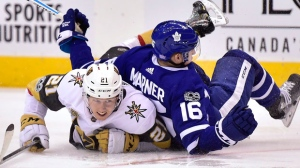 Toronto Maple Leafs centre Mitchell Marner (16) gets tangled up with Vegas Golden Knights centre Cody Eakin (21) during third period NHL hockey action in Toronto on Monday, Nov. 6, 2017. THE CANADIAN PRESS/Frank Gunn