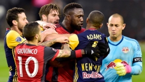 Toronto FC forward Jozy Altidore (17) scuffles with New York Red Bulls midfielder Tyler Adams (4) after teammate Sebastian Giovinco (10) was pushed to the ground during first half MLS soccer action in Toronto on Sunday, November 5, 2017. THE CANADIAN PRESS/Frank Gunn
