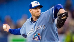 Toronto Blue Jays starting pitcher Roy Halladay throws against the Seattle Mariners during first inning AL baseball game action in Toronto September 25, 2009. (THE CANADIAN PRESS/Fred Thornhill)