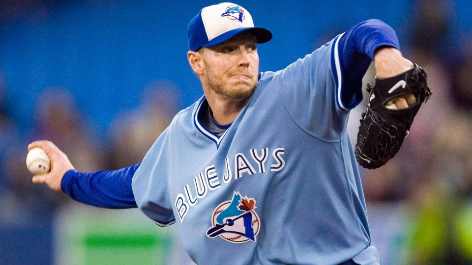 Toronto Blue Jays starting pitcher Roy Halladay throws against the Seattle Mariners during first inning AL baseball game action in Toronto September 25, 2009. THE CANADIAN PRESS/Fred Thornhill