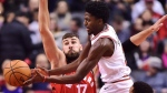 Chicago Bulls guard Justin Holiday (7) passes the ball as Toronto Raptors centre Jonas Valanciunas (17) defends during first half NBA basketball action in Toronto on Tuesday, November 7, 2017. THE CANADIAN PRESS/Frank Gunn