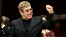 Musician Elton John gestures before being presented with the Harvard Humanitarian of the Year Award during ceremonies Monday, Nov. 6, 2017, on the campus of Harvard University, in Cambridge, Mass. (AP Photo/Steven Senne)