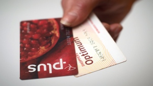 A Loblaws PC Plus and a Shoppers Drug Mart Optimum card are shown together in Toronto on Tuesday. THE CANADIAN PRESS/Graeme Roy