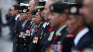 Canadian military members who served in Afghanistan look on as the B.C. Afghanistan Memorial, an 18,000 pound slab of granite honouring Canadian soldiers and civilians who served in Afghanistan between 2001-2014, is unveiled during a dedication ceremony in Victoria, B.C., on Saturday, September 30, 2017. THE CANADIAN PRESS/Chad Hipolito