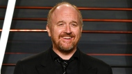 FILE - In this Feb. 28, 2016 file photo, Louis C.K. arrives at the Vanity Fair Oscar Party in Beverly Hills, Calif. The actor-comedian has pushed pause on his FX series and is launching a year-long stand-up comedy tour comprised of all-new material. (Photo by Evan Agostini/Invision/AP, File)