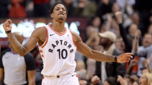 Toronto Raptors guard DeMar DeRozan (10) reacts after sinking a 2-point basket in the final seconds of second half NBA basketball action against the New Orleans Pelicans, in Toronto on Thursday, November 9, 2017. THE CANADIAN PRESS/Nathan Denette