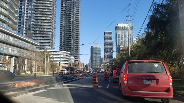 Traffic slowed to a standstill on the eastbound Lakeshore on Nov. 10 after a water main ruptured nearby and streetcar track maintenance reduced lanes.