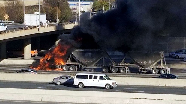 A truck is seen englufed in flames on Highway 427 near Bloor Street. (Twitter/Danny Philp)