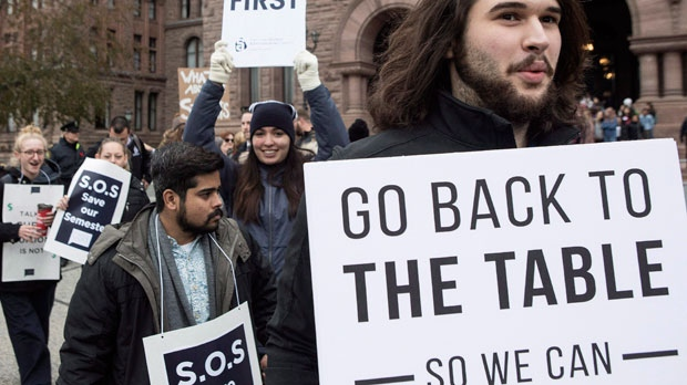 Students demonstrate outside the Ontario Legislature in Toronto on Wednesday November 1, 2017, as they protest against the ongoing strike by Ontario faculty members. THE CANADIAN PRESS/Chris Young