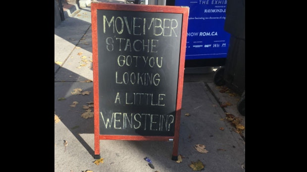 A sign located outside Mankind Grooming barber shop in Parkdale is shown. (Twitter/Erica Shiner)