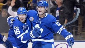 Toronto Maple Leafs centre Patrick Marleau (12) celebrates his game-winning goal against the Boston Bruins with centre Mitchell Marner (16) during overtime NHL hockey action in Toronto on Friday, November 10, 2017. THE CANADIAN PRESS/Nathan Denette