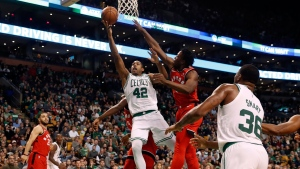 Boston Celtics' Al Horford goes to the basket past Toronto Raptors' OG Anunoby during the fourth quarter of Boston's 95-94 win in an NBA basketball game in Boston, Sunday, Nov. 12, 2017. (AP Photo/Winslow Townson)