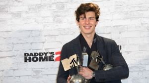 Singer Shawn Mendes poses for photographers with his awards for Best Song and Best Artist backstage at the MTV European Music Awards 2017 in London, Sunday, Nov. 12th, 2017. (Photo by Vianney Le Caer/Invision/AP)