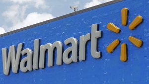 This Thursday, June 1, 2017, file photo, shows a Walmart sign at a store in Hialeah Gardens, Fla. (AP Photo/Alan Diaz, File)
