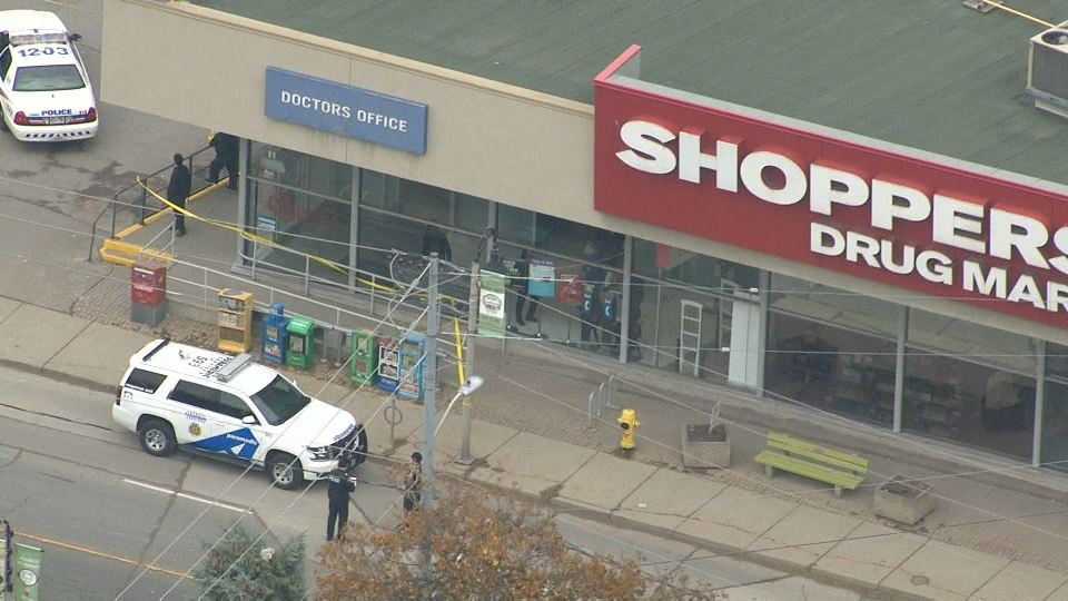 Police investigate a fatal stabbing outside a Shopper's Drug Mart on Weston Road near Lawrence Avenue Tuesday November 14, 2017.