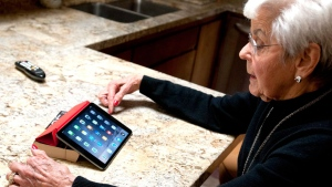 In this Feb. 18, 2015 photo, Dorie Thorpe talks about her use of technology during an interview at her Logan, Utah home. (AP Photo/Herald Journal, John Zsiray)