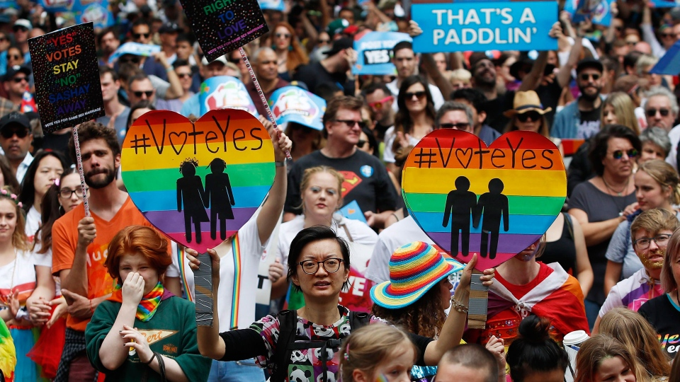In this Saturday, Oct. 21, 2017 file photo, supporters of marriage equality march near Victoria Park in Sydney, Australia. (Daniel Munoz/AAP Image via AP, File)