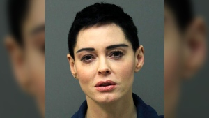 This image released Tuesday, Nov. 14, 2017 by the Loudoun County Sheriff's Office shows the booking photo for actress Rose McGowan who surrendered to Airports Authority Police on charges of possession of a controlled substance. (Loudoun County Sheriff's Office via AP)