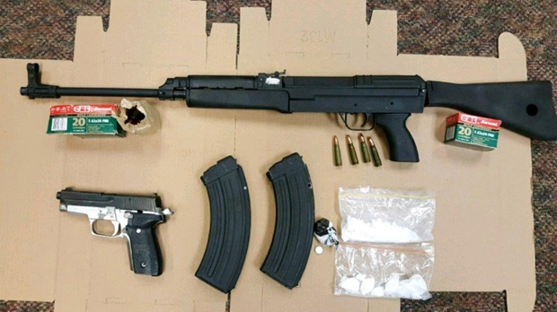 An assault-style rifle, a 9mm handgun, prohibited magazines, drugs and ammunition are shown in a handout image. (DRPS)