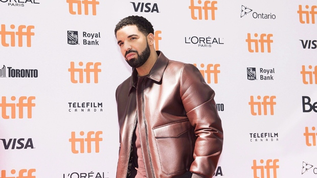 Canadian rapper Drake poses for photographs on the red carpet during the 2017 Toronto International Film Festival in Toronto on Saturday, September 9, 2017. Drake is being praised after issuing a stern warning to a fan to stop touching women at a performance in Australia this week. THE CANADIAN PRESS/Nathan Denette