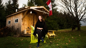Bryna Rabishaw poses for a photograph in front of her late husband Kevin Rabishaw's sugar shack, which he made homemade maple syrup in at their home in Sharon, Ont., on Tuesday, November 14, 2017. Despite having surgery to remove a large tumour on his pancreas, followed by rounds of chemotherapy, Kevin Rabishaw died last month at age 57, just nine months after his diagnosis. THE CANADIAN PRESS/Nathan Denette