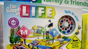 "FILE - In this Nov. 11, 2015 file photo, the Hasbro board game ""The Game of Life"" rests on a shelf in a toy store in North Attleboro, Mass. A trial begins Thursday, Nov. 16, 2017, in federal court in Los Angeles over who invented the game and who owns the rights to it. (AP Photo/Steven Senne, File)"
