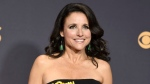"""FILE - In this Sept. 17, 2017 file photo, Julia Louis-Dreyfus arrives at the 69th Primetime Emmy Awards in Los Angeles. A producer of """"Veep"""" says filming of the HBO comedy has been postponed as its star, Julia Louis-Dreyfus, undergoes treatment for breast cancer. During an interview on SiriusXM Wednesday, Nov. 15, Frank Rich said production of the new season was awaiting her recovery. (Photo by Richard Shotwell/Invision/AP, File)"""