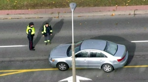 Toronto police are seen investigating after two pedestrians were struck in the Bayview Village area on Thursday.