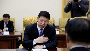 Song Tao, the head of China's ruling Communist Party's International Liaison Department, speaks with Choe Ryong Hae, right, vice chairman of the Central Committee of North Korea's ruling party after arriving in Pyongyang, Friday, Nov. 17, 2017. The highest-level Chinese envoy to North Korea in two years arrived in the country's capital on Friday to try to improve relations that have soured over Beijing's tightening of sanctions and expressions of support for U.S. President Donald Trump's calls for more pressure on the North to abandon its nuclear weapons program. (AP Photo/Kim Kwang Hyon)
