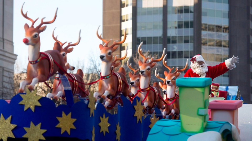 Santa Claus waves to the crowd from his float during the Santa Claus Parade in Toronto on Sunday, Nov. 15, 2015. THE CANADIAN PRESS/Marta Iwanek