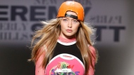 In this Friday, Sept. 8, 2017, file photo, Gigi Hadid models fashion from the Jeremy Scott spring 2018 collection during Fashion Week in New York.  Hadid says she will not be walking the Victoria's Secret fashion show in Shanghai next week. In a post on her Twitter account Friday, Hadid did not explain why she would be missing the show and Victoria's Secret refused to comment on the issue. (AP Photo/Jason DeCrow, File)