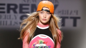 In this Friday, Sept. 8, 2017, file photo, Gigi Hadid models fashion from the Jeremy Scott spring 2018 collection during Fashion Week in New York. (AP Photo/Jason DeCrow, File)